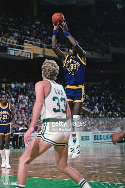 Jerome Whitehead of the Golden State Warriors shoots a jump shot against Larry Bird of the Boston Celtics during a game played in 1985 at the Boston...