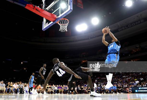 Jerome Williams of Power shoots against Ivan Johnson of the Ghost Ballers during week four of the BIG3 three on three basketball league at Wells...