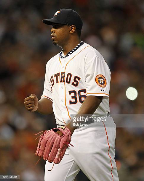 Jerome Williams of the Houston Astros pumps his fist after retiring the side in the sixth inning against the New York Yankees at Minute Maid Park on...
