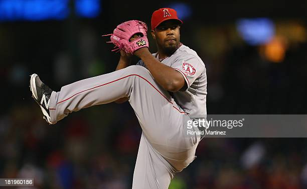 Jerome Williams of the Los Angeles Angels throws against the Texas Rangers in the first inning at Rangers Ballpark in Arlington on September 26 2013...
