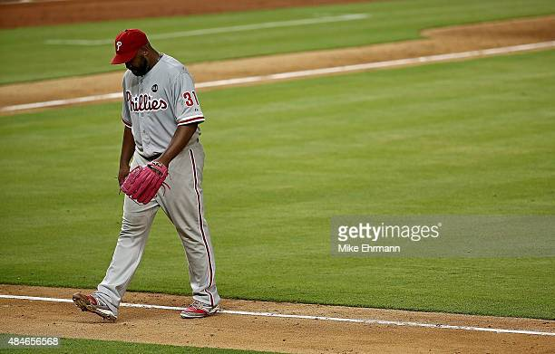 Jerome Williams of the Philadelphia Phillies walks off the field after being pulled in the second inning during a game against the Miami Marlins at...