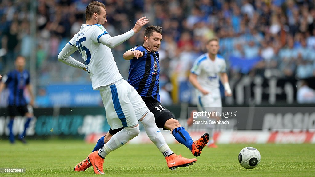Jeron Al-Hazaimeh of Lotte and Giuseppe Burgio of Mannheim battle for the ball during the 3. Liga playoff leg 2 match between Waldhof Mannheim and Sportfreunde Lotte at Carl-Benz-Stadion on May 29, 2016 in Lotte, Germany.