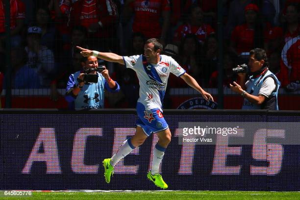 Jeronimo Amione of Puebla celebrates after scoring the second goal of his team during the 8th round match between Toluca and Puebla as part of the...
