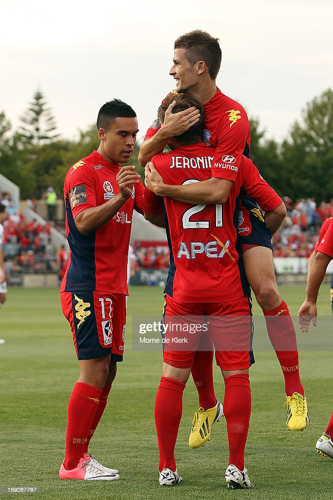 Jeronimo Neumann of Adelaide is congratulated by his team mates after he scored a goal during the round 16 A-League match between Adelaide United and the Perth Glory at Hindmarsh Stadium on January 11, 2013 in Adelaide, Australia.