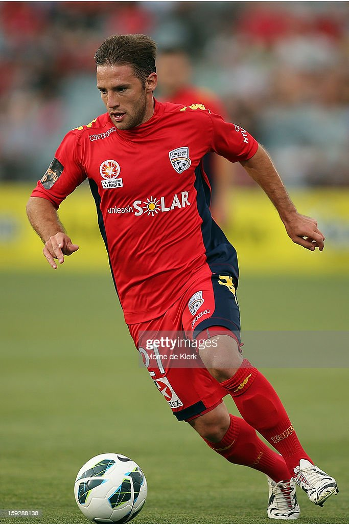 Jeronimo Neumann of Adelaide runs with the ball during the round 16 A-League match between Adelaide United and the Perth Glory at Hindmarsh Stadium on January 11, 2013 in Adelaide, Australia.