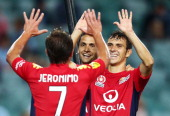 Jeronimo Neumann of United celebrates with team mates after scoring the third goal during the round 18 ALeague match between Sydney FC and Adelaide...