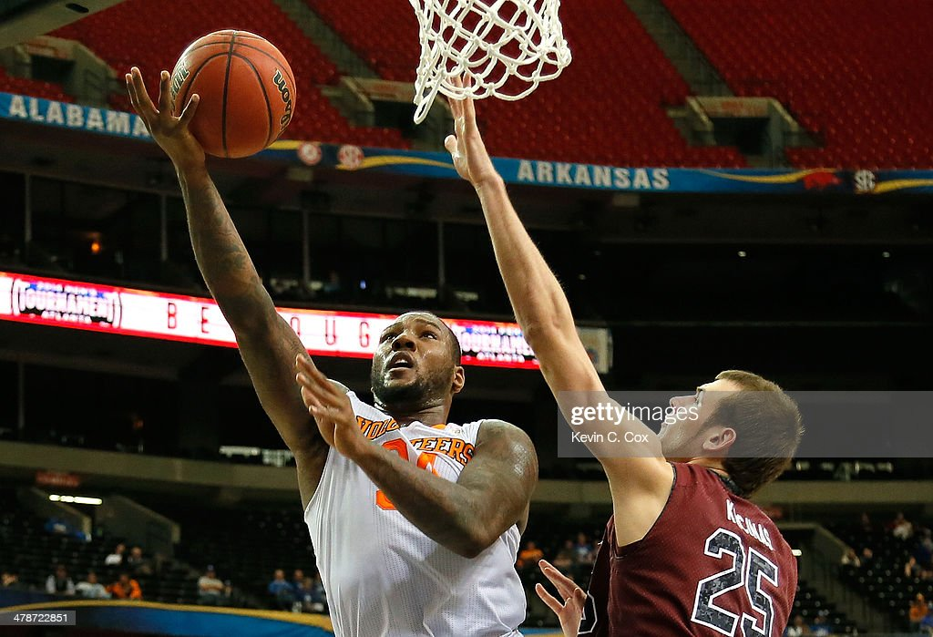 Jeronne Maymon #34 of the Tennessee Volunteers attacks against Mindaugas Kacinas #25 of the South Carolina Gamecocks during the quarterfinals of the SEC Men's Basketball Tournament at Georgia Dome on March 14, 2014 in Atlanta, Georgia.