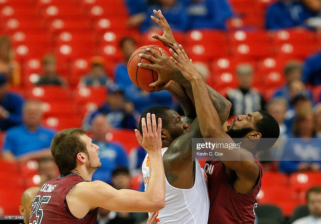 Jeronne Maymon #34 of the Tennessee Volunteers draws a foul from Desmond Ringer #32 of the South Carolina Gamecocks during the quarterfinals of the SEC Men's Basketball Tournament at Georgia Dome on March 14, 2014 in Atlanta, Georgia.