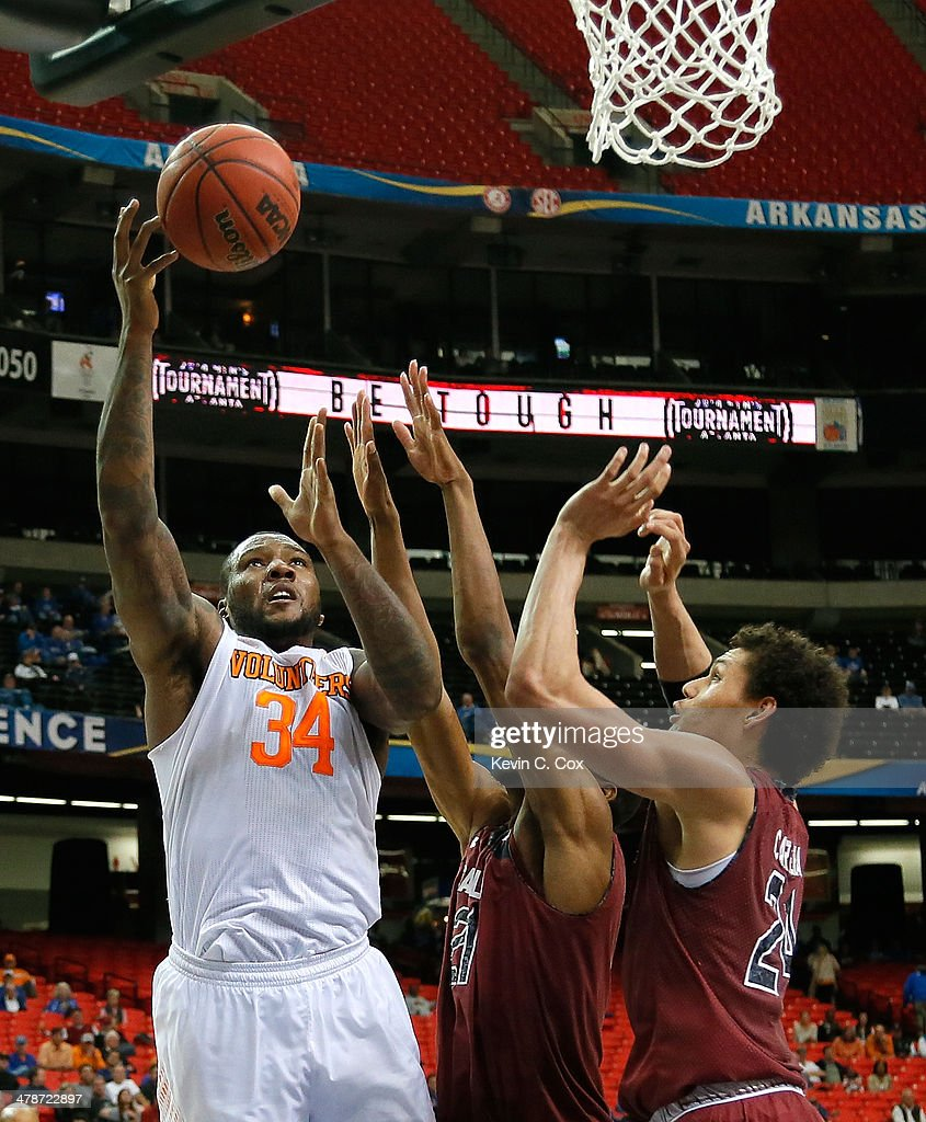 Jeronne Maymon #34 of the Tennessee Volunteers shoots against Demetrius Henry #21 and Michael Carrera #24 of the South Carolina Gamecocks during the quarterfinals of the SEC Men's Basketball Tournament at Georgia Dome on March 14, 2014 in Atlanta, Georgia.