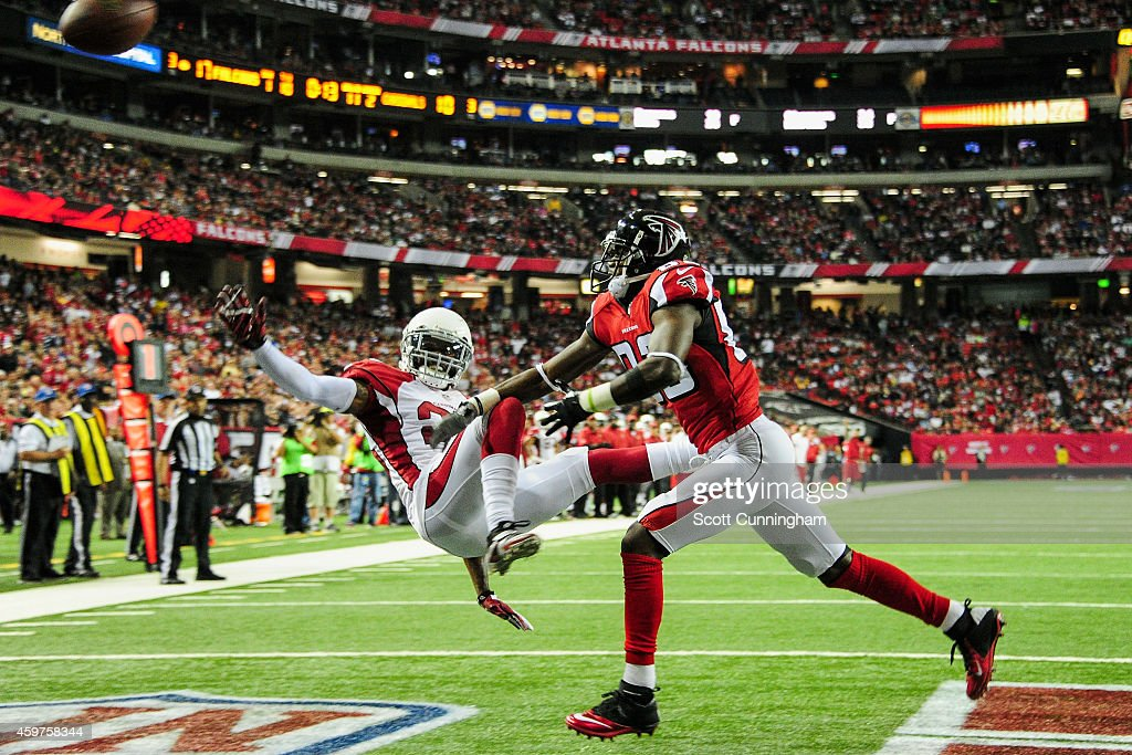 Jerraud Powers of the Arizona Cardinals breaks up a pass intended for Harry Douglas of the Atlanta Falcons during the first half at the Georgia Dome...