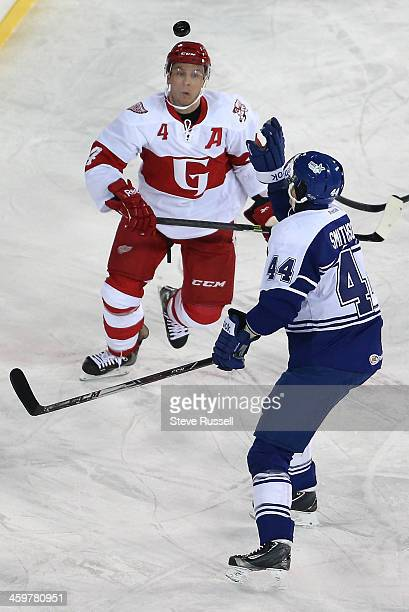 DETROIT MI DECEMBER 30 Jerred Smithson looks to grab the puck as Nathan Paetsch looks for it as the Toronto Marlies play the Grand Rapid Griffins...