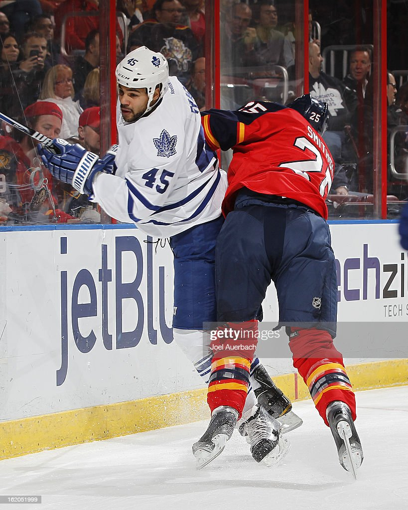 Jerred Smithson #25 of the Florida Panthers checks Mark Fraser #45 of the Toronto Maple Leafs at the BB&T Center on February 18, 2013 in Sunrise, Florida.