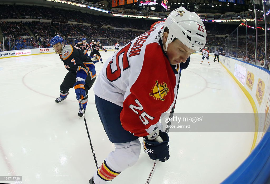 <a gi-track='captionPersonalityLinkClicked' href=/galleries/search?phrase=Jerred+Smithson&family=editorial&specificpeople=224622 ng-click='$event.stopPropagation()'>Jerred Smithson</a> #25 of the Florida Panthers skates against the New York Islanders at the Nassau Veterans Memorial Coliseum on March 24, 2013 in Uniondale, New York.