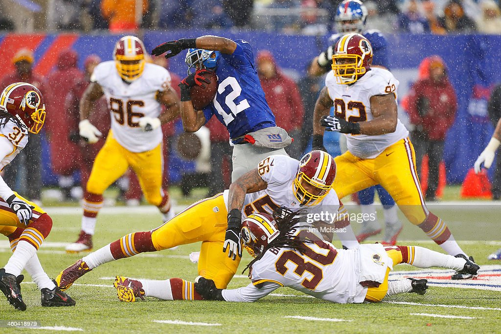 Jerrel Jernigan of the New York Giants runs a reception against Perry Riley and EJ Biggers of the Washington Redskins at MetLife Stadium on Sunday...