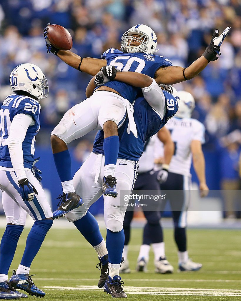 Jerrell Freeman of the Indianapolis Colts celebrates with Ricardo Matthews after he intercepted a pass late in the fourth quarter during the NFL game...