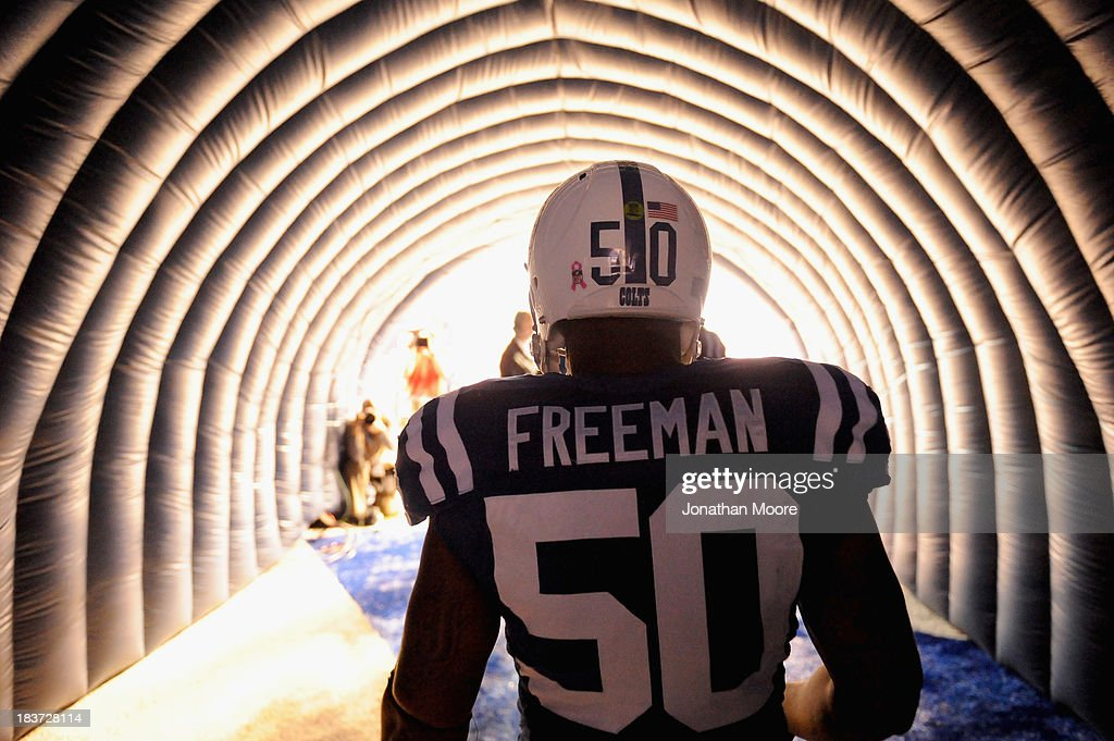 <a gi-track='captionPersonalityLinkClicked' href=/galleries/search?phrase=Jerrell+Freeman&family=editorial&specificpeople=5441871 ng-click='$event.stopPropagation()'>Jerrell Freeman</a> #50 of the Indianapolis Colts enters the arena before a game against the Seattle Seahawks at Lucas Oil Stadium on October 6, 2013 in Indianapolis, Indiana.