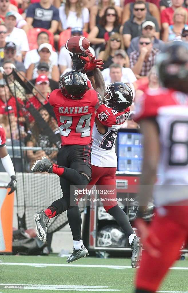 Jerrell Gavins #24 of the Ottawa Redblacks breaks up a pass intended for Sederrik Cunningham #89 of the Calgary Stampeders during a CFL game at TD Place Stadium on August 24, 2014 in Ottawa, Ontario, Canada.