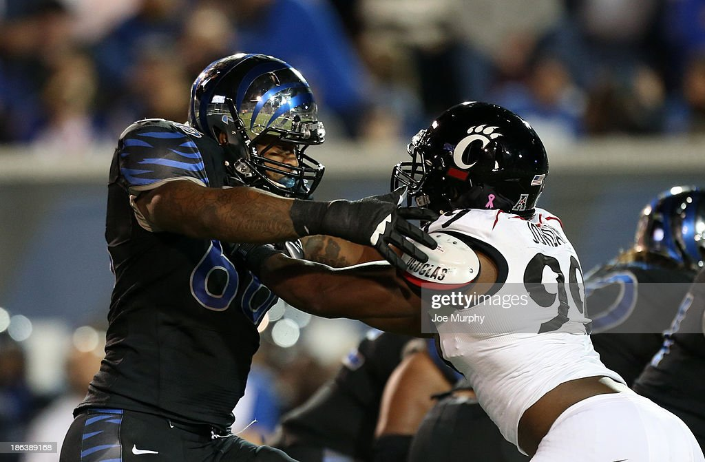 Jerrell Jordan #99 of the Cincinnati Bearcats rushes against Tony Mays #66 of the Memphis Tigers on October 30, 2013 at Liberty Bowl Memorial Stadium in Memphis, Tennessee.