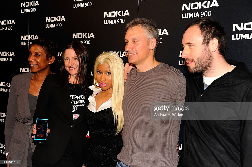 Jerri DeVard, Chief Marketing Officer, Nokia, Valerie Buckingham, Marketing director, Nokia North America, Nicki Minaj, Chris Weber President of Nokia, North America and DJ Doorly arrive at Times Square to watch Nicki Minaj team up with Nokia to perform live for the launch of the Windows Phone-based Nokia Lumia 900 in North America at R Lounge at the Renaissance New York Times Square Hotel on April 6, 2012 in New York City. Tens of thousands of people watched as a building appeared to 'come alive' in the heart of New York City. Nine of Times Square's famous electronic screens captured the reaction of the crowds. The entire show was filmed as a backdrop for the music video for the exclusive Nokia Lumia 900 remix of Minaj's hit 'Starships'. The Windows Phone-based Nokia Lumia 900 will be available in unique and eye-catching cyan blue and a matte black with a new high-gloss white version on sale later this month. To watch more of the amazing event go to www.facebook.com/nokiaus