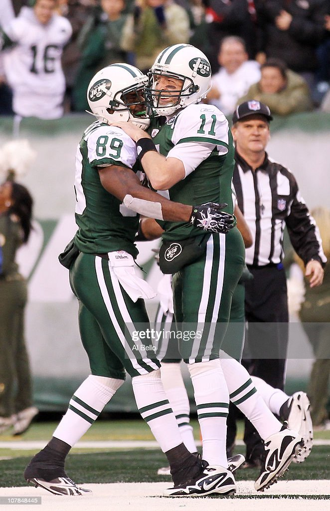 Jerricho Cotchery #89 and Kellen Clemens #11 of the New York Jets celebrate during their game against the Buffalo Bills at New Meadowlands Stadium on January 2, 2011 in East Rutherford, New Jersey.