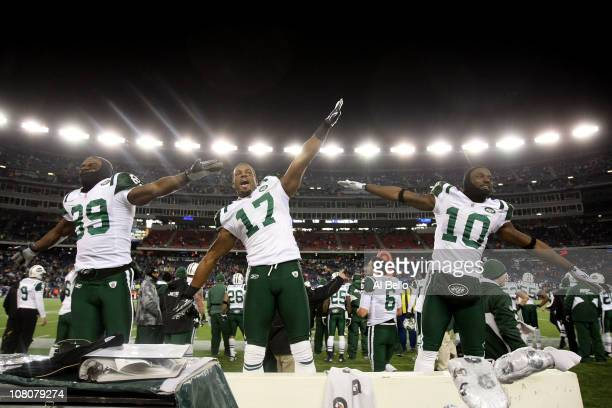 Jerricho Cotchery Braylon Edwards and Santonio Holmes of the New York Jets celebrate their 28 to 21 victory over the New England Patriots during...