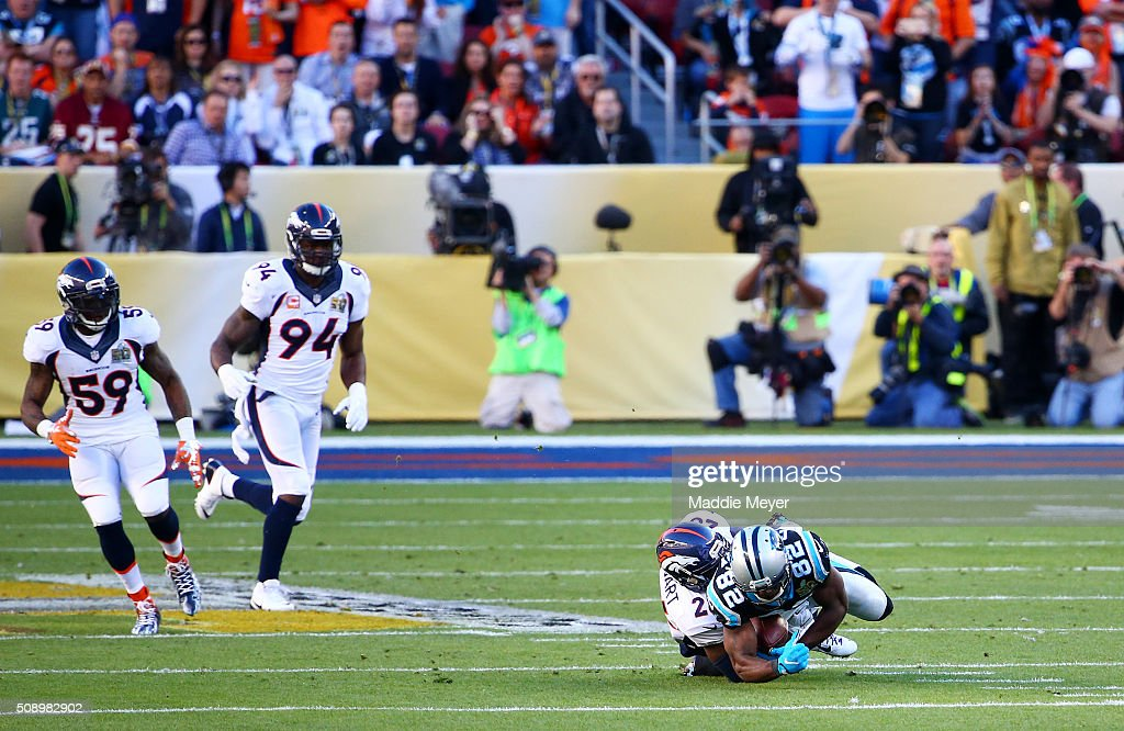 <a gi-track='captionPersonalityLinkClicked' href=/galleries/search?phrase=Jerricho+Cotchery&family=editorial&specificpeople=567181 ng-click='$event.stopPropagation()'>Jerricho Cotchery</a> #82 of the Carolina Panthers is tackled by <a gi-track='captionPersonalityLinkClicked' href=/galleries/search?phrase=Darian+Stewart&family=editorial&specificpeople=4542671 ng-click='$event.stopPropagation()'>Darian Stewart</a> #26 of the Denver Broncos in the first quarter during Super Bowl 50 at Levi's Stadium on February 7, 2016 in Santa Clara, California.