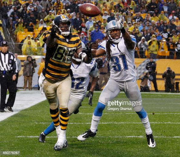 Jerricho Cotchery of the Pittsburgh Steelers can't make a fourth quarter catch in the end zone while being covered by Rashean Mathis of the Detroit...