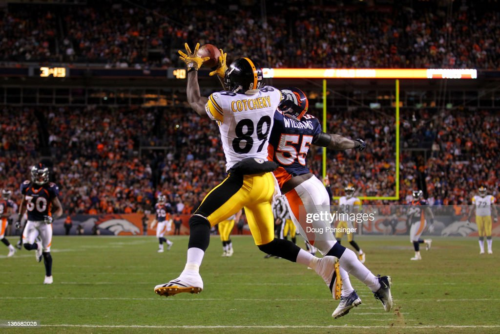 <a gi-track='captionPersonalityLinkClicked' href=/galleries/search?phrase=Jerricho+Cotchery&family=editorial&specificpeople=567181 ng-click='$event.stopPropagation()'>Jerricho Cotchery</a> #89 of the Pittsburgh Steelers catches a touchdown pass to tie the game in fourth quarter against <a gi-track='captionPersonalityLinkClicked' href=/galleries/search?phrase=D.J.+Williams+-+American+Football+Linebacker&family=editorial&specificpeople=224565 ng-click='$event.stopPropagation()'>D.J. Williams</a> #55 of the Denver Broncos during the AFC Wild Card Playoff game at Sports Authority Field at Mile High on January 8, 2012 in Denver, Colorado.