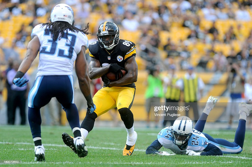 <a gi-track='captionPersonalityLinkClicked' href=/galleries/search?phrase=Jerricho+Cotchery&family=editorial&specificpeople=567181 ng-click='$event.stopPropagation()'>Jerricho Cotchery</a> #89 of the Pittsburgh Steelers catches a touchdown pass against the Tennessee Titans during the fourth quarter at Heinz Field on September 8, 2013 in Pittsburgh, Pennsylvania.