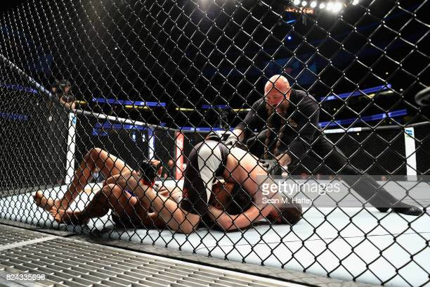 Jerrod Brooks fights Eric Shelton during their Flyweight bout at UFC 214 at Honda Center on July 29 2017 in Anaheim California