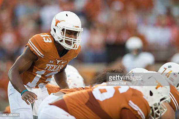 Jerrod Heard of the Texas Longhorns calls a play at the line of scrimmage against the Rice Owls during the first quarter on September 12 2015 at...