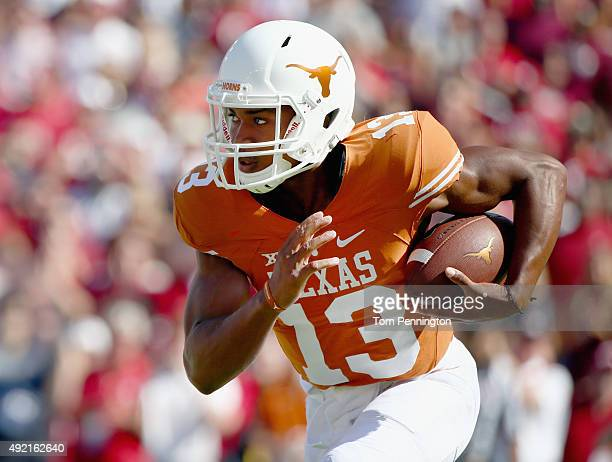 Jerrod Heard of the Texas Longhorns carries the ball against the Oklahoma Sooners in the first quarter during the ATT Red River Showdown at the...