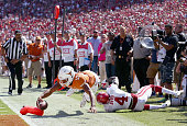Jerrod Heard of the Texas Longhorns dives into the end zone with the ball against Hatari Byrd of the Oklahoma Sooners in the second half during the...