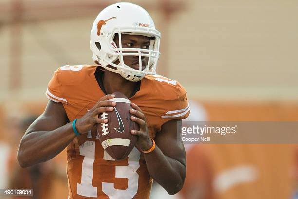 Jerrod Heard of the Texas Longhorns drops back to pass against the Oklahoma State Cowboys during the 4th quarter on September 26 2015 at Darrell K...