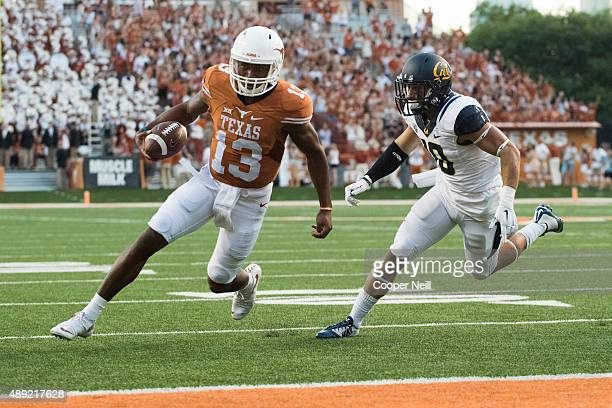 Jerrod Heard of the Texas Longhorns scrambles for a 2 yard touchdown run against the California Golden Bears during the first quarter on September 19...