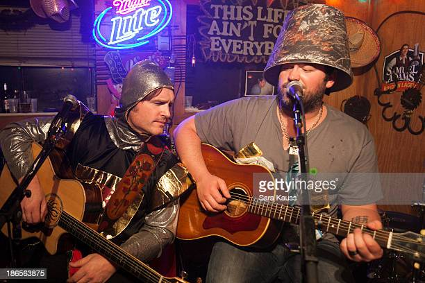Jerrod Niemann and Lee Brice perform at the TJ Martell Foundation's Battle for the Bones for the Linds Sarcoma Fund at Losers Bar Grill on October 31...