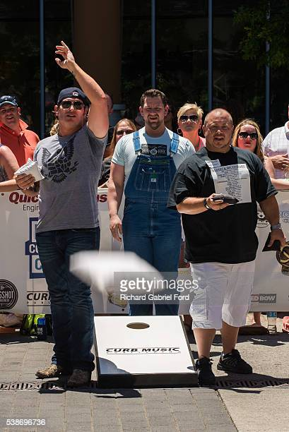 Jerrod Niemann Big Vinny and Chris Bennett attend the Craig Campbell celebrity cornhole challange on June 7 2016 in Nashville Tennessee