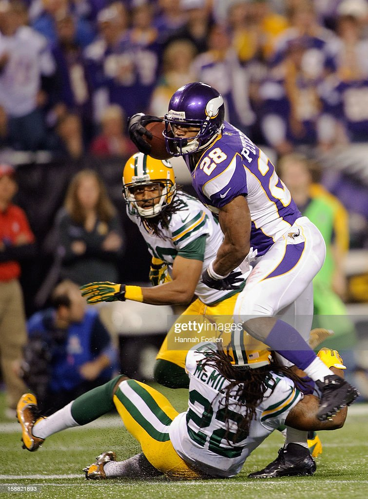 Jerron McMillian #22 of the Green Bay Packers tackles Adrian Peterson #28 of the Minnesota Vikings during the fourth quarter of the game on December 30, 2012 at Mall of America Field at the Hubert H. Humphrey Metrodome in Minneapolis, Minnesota. The Vikings defeated the Packers 37-34.