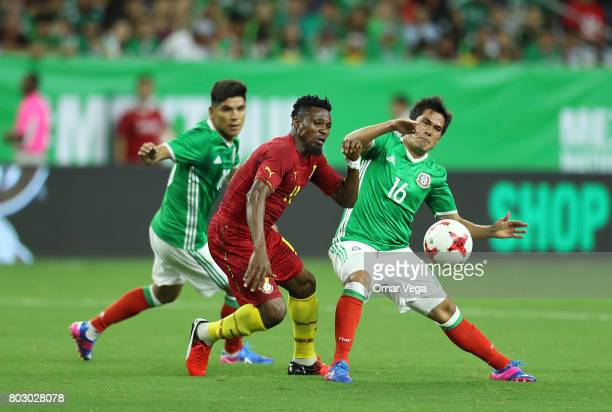 Jerry Akaminko of Ghana fights for the ball with Jorge Hernandez of Mexico during the friendly match between Mexico and Ghana at NRG Stadium on June...