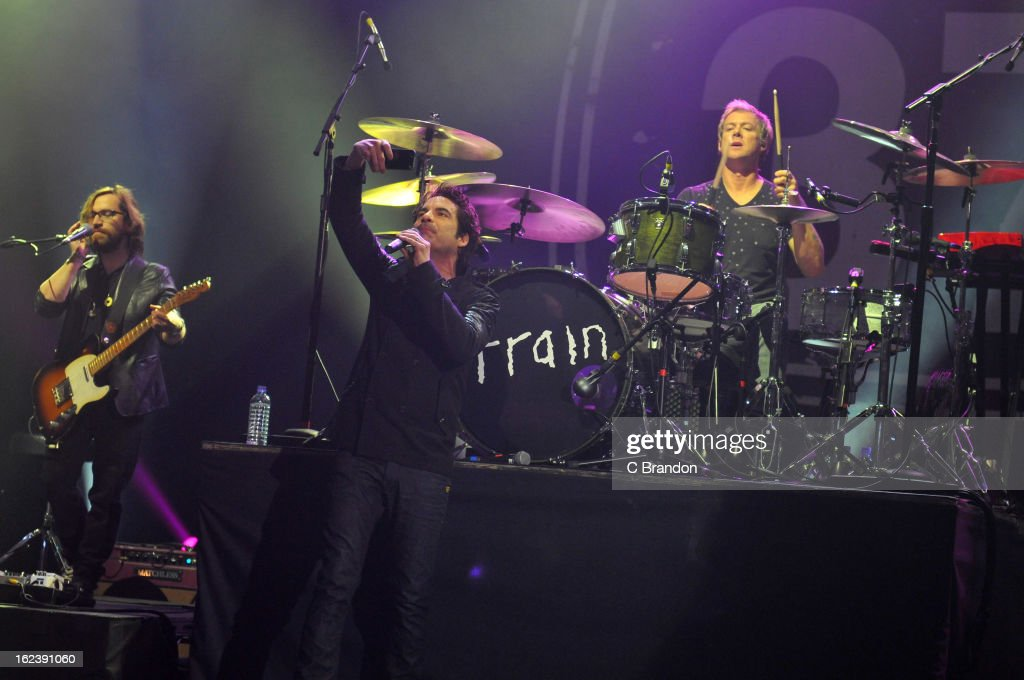 Jerry Becker, Pat Monahan and Scott Underwood of Train perform on stage at Hammersmith Apollo on February 22, 2013 in London, England.