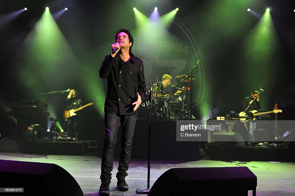 Jerry Becker, Pat Monahan, Scott Underwood and Hector Maldonado of Train perform on stage at Hammersmith Apollo on February 22, 2013 in London, England.