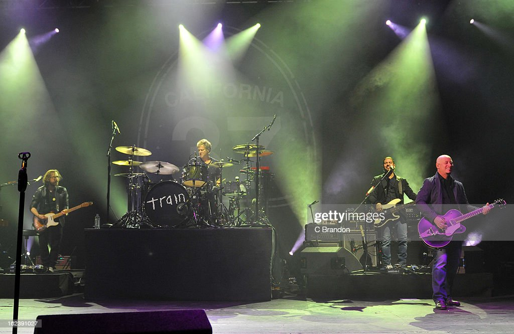 Jerry Becker, Scott Underwood, Hector Maldonado and Jimmy Stafford of Train perform on stage at Hammersmith Apollo on February 22, 2013 in London, England.