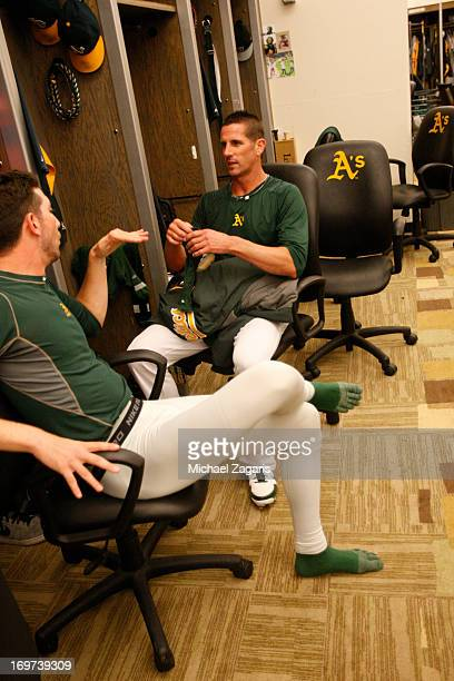 Jerry Blevins and Grant Balfour of the Oakland Athletics relax in the clubhouse following the game against the Kansas City Royals at Oco Coliseum on...