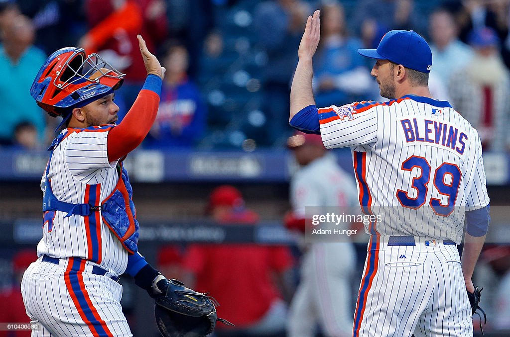 Jerry Blevins #39 of the New York Mets and Rene Rivera #44 of the New York Mets celebrate their win over the Philadelphia Phillies at Citi Field on September 25, 2016 in the Flushing neighborhood of the Queens borough of New York City. The Mets won 17-0.