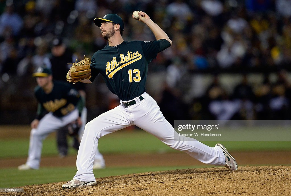 <a gi-track='captionPersonalityLinkClicked' href=/galleries/search?phrase=Jerry+Blevins&family=editorial&specificpeople=4525141 ng-click='$event.stopPropagation()'>Jerry Blevins</a> #13 of the Oakland Athletics pitches in the eighth inning against the New York Yankees at O.co Coliseum on June 11, 2013 in Oakland, California.
