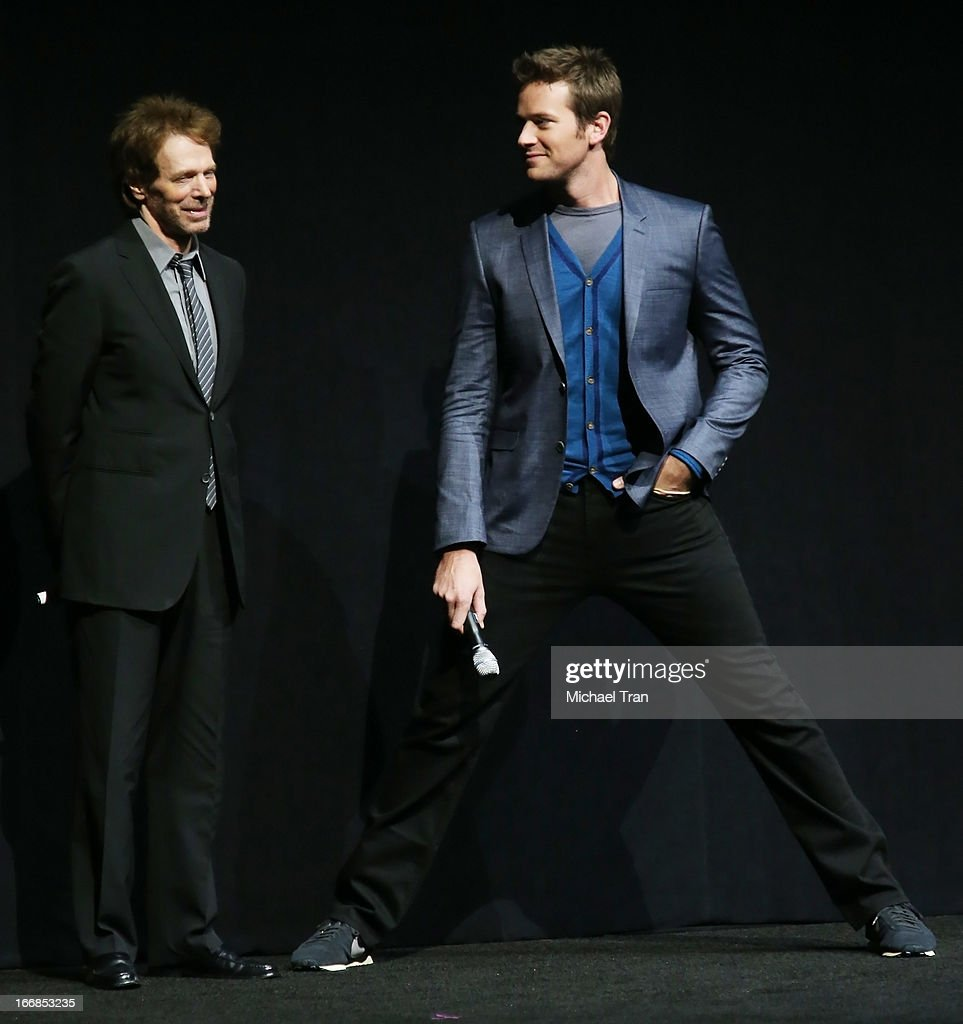 Jerry Bruckheimer (L) and Armie Hammer appear at a Walt Disney Studios Motion Pictures presentation to promote the upcoming film 'The Lone Ranger' held at The Colosseum at Caesars Palace during CinemaCon, the official convention of the National Association of Theatre Owners on April 17, 2013 in Las Vegas, Nevada.