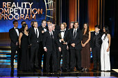 Jerry Bruckheimer and crew of 'The Amazing Race' appear onstage during the 66th Annual Primetime Emmy Awards held at Nokia Theatre LA Live on August...
