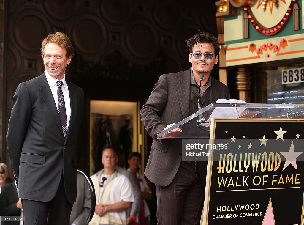 <a gi-track='captionPersonalityLinkClicked' href=/galleries/search?phrase=Jerry+Bruckheimer&family=editorial&specificpeople=203316 ng-click='$event.stopPropagation()'>Jerry Bruckheimer</a> (L) and <a gi-track='captionPersonalityLinkClicked' href=/galleries/search?phrase=Johnny+Depp&family=editorial&specificpeople=202150 ng-click='$event.stopPropagation()'>Johnny Depp</a> attend the ceremony honoring <a gi-track='captionPersonalityLinkClicked' href=/galleries/search?phrase=Jerry+Bruckheimer&family=editorial&specificpeople=203316 ng-click='$event.stopPropagation()'>Jerry Bruckheimer</a> with a Star on The Hollywood Walk of Fame held in front of El Capitan Theatre on June 24, 2013 in Hollywood, California.