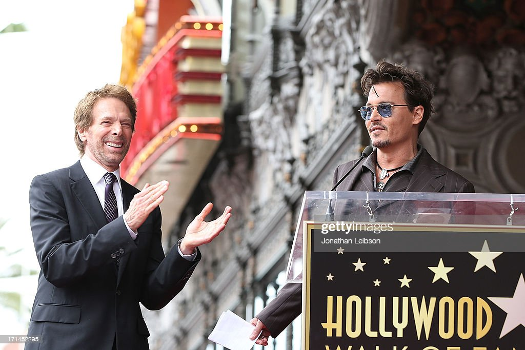 <a gi-track='captionPersonalityLinkClicked' href=/galleries/search?phrase=Jerry+Bruckheimer&family=editorial&specificpeople=203316 ng-click='$event.stopPropagation()'>Jerry Bruckheimer</a> and <a gi-track='captionPersonalityLinkClicked' href=/galleries/search?phrase=Johnny+Depp&family=editorial&specificpeople=202150 ng-click='$event.stopPropagation()'>Johnny Depp</a> attend the ceremony honoring <a gi-track='captionPersonalityLinkClicked' href=/galleries/search?phrase=Jerry+Bruckheimer&family=editorial&specificpeople=203316 ng-click='$event.stopPropagation()'>Jerry Bruckheimer</a> with a Star on The Hollywood Walk of Fame held in front of El Capitan Theatre on June 24, 2013 in Hollywood, California.