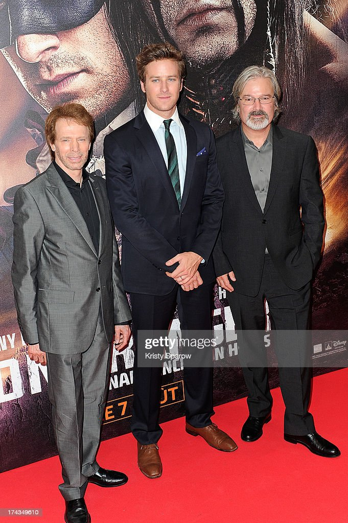 Jerry Bruckheimer Armie Hammer and Gore Verbinski attend the Paris Premiere of 'The Lone Ranger' at Cinema UGC Normandie on July 24 2013 in Paris...